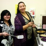 Youth Group Member Cooking with Leader