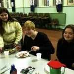 Youth Group Members Eating at Table